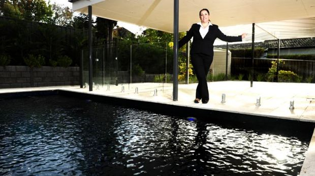 The luxury Red Hill property also boasts a swimming pool.