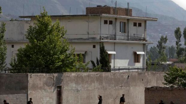 Members of Pakistan's anti-terrorism squad are seen surrounding the compound two days after al-Qaeda leader Osama bin ...
