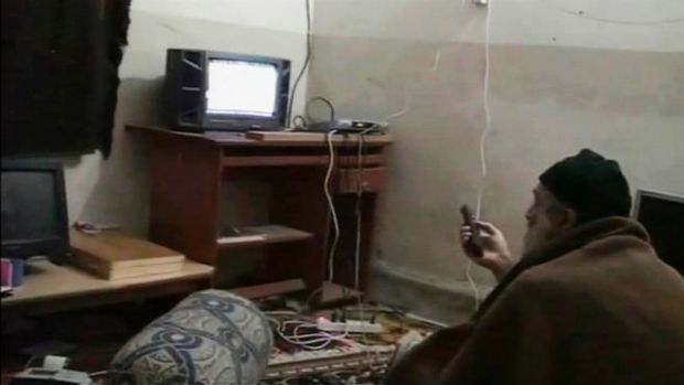 Osama bin Laden is shown watching himself on television while in his Pakistan compound in this video frame grab released ...