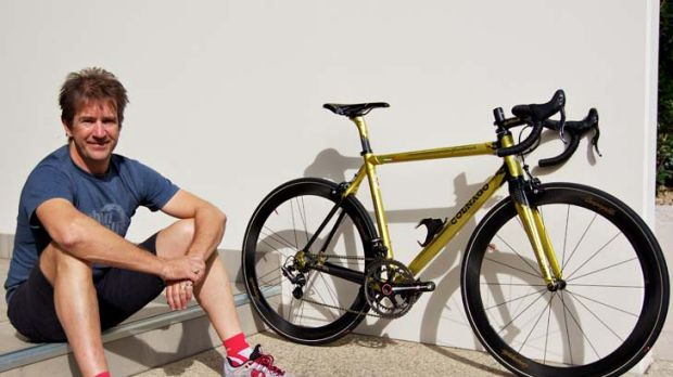 Wild ride … Urban Cycles' Craig Klement with a $17,000 gold-coloured Colnago C59 Ottanta.