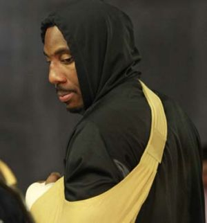 New York Knicks forward Amare Stoudemire with his hand in a sling.