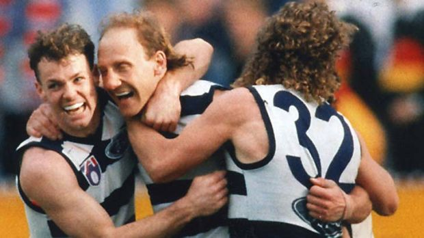Gary Ablett Snr with Geelong teammates Michael Mansfield and Garry Hocking at the MCG in 1994.  Originally filed: 26-09-1994