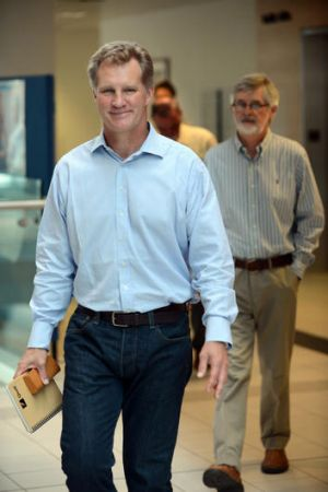 Wallabies great Michael Lynagh (left) and his father Ian at the Royal Brisbane hospital yesterday.