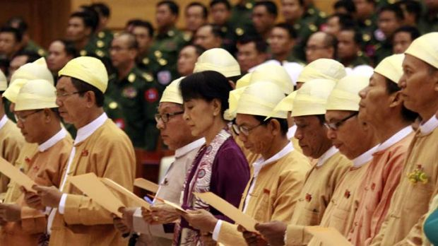 More than words ... Burma's Opposition leader and pro-democracy advocate Aung San Suu Kyi reads an oath with other ...