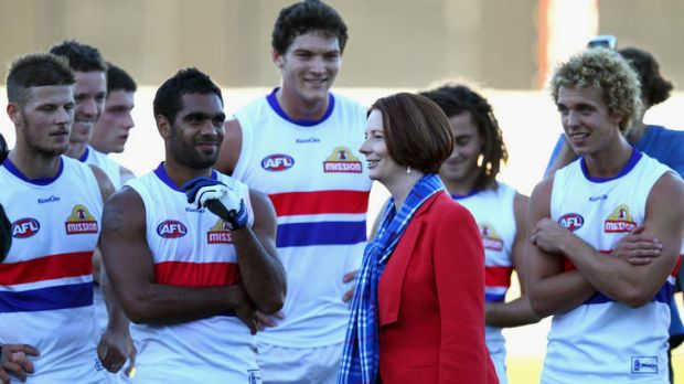 PM Julia Gillard congratulates the Bulldogs after their match against Greater Western Sydney at Manuka Oval on April 28.