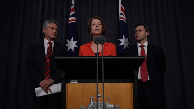The Gillard government announces cuts to Defence spending - while revealing a $214 million in funding for 12 submarines.