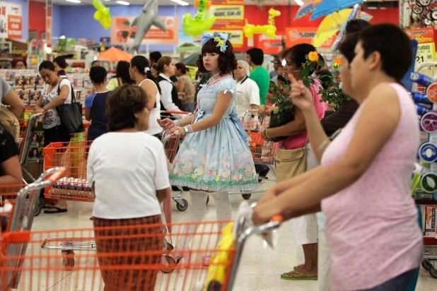 Alin Nava (C) stands in a checkout line at a supermarket in Monterrey, Mexico.