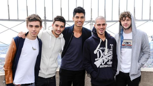British boy band The Wanted, from left, Nathan Sykes, Tom Parker, Siva Kaneswaran, Max George and Jay McGuiness visit ...