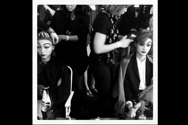 Models prepare backstage prior to the Romance Was Born catwalk show.