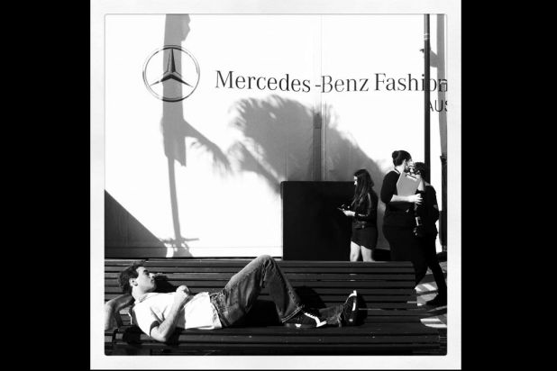 A man sleeps outside The Tent during Mercedes-Benz Fashion Week Australia Spring/Summer 2012/13 at Overseas Passenger ...