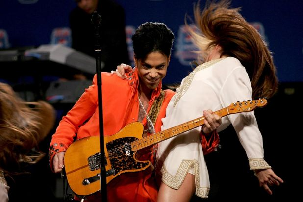 Musician Prince performs during the Super Bowl XLI Half-Time Press Conference at the Miami Convention Center on February ...