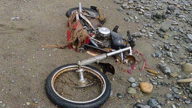 A Harley-Davidson motorbike lost in last year's tsunami lies on a beach in Graham Island, western Canada.