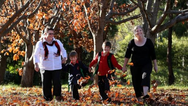 Heart Attack survivor Carol Jones with grandsons Keanan Patron, 5, Samuel Patron, 8, and daughter Elizabeth Patron walk ...