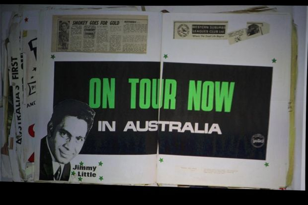 A page from his scrapbook that was projected on the screen.