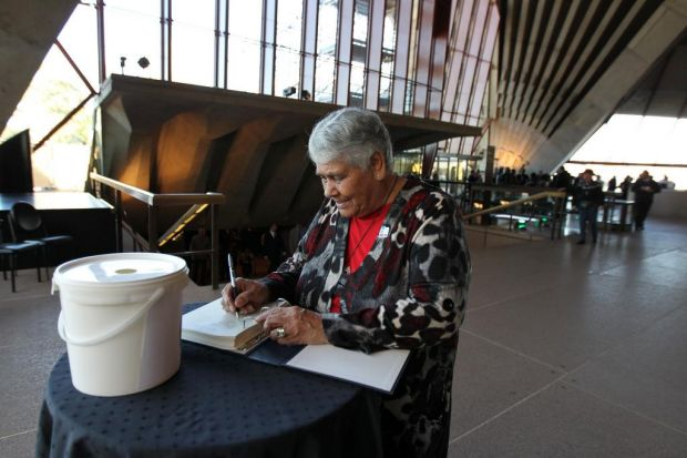 """Lowitja """"Lois"""" O'Donoghue signs the book of condolences."""