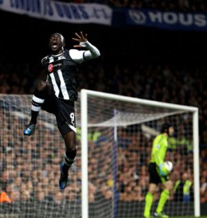 Newcastle striker Papiss Demba Cisse celebrates his astonishing goal, which appeared to defy the laws of physics.