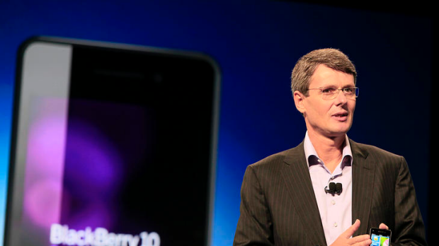 RIM CEO Thorsten Heins shows off a prototype device running the company's BlackBerry 10 software at BlackBerry World ...