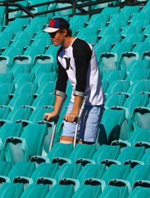 Doing his best … Gary Rohan, on crutches at the SCG yesterday, admits he won't enjoy being a spectator but will ...
