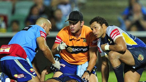 Callous blow ... Johnathan Thurston of the Cowboys receives treatment after being elbowed by Matt Prior.