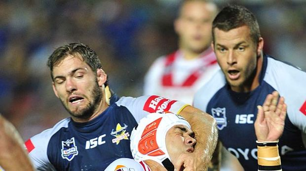 Caught high ... Jamie Soward of the Dragons is tackled by Dallas Johnson of the Cowboys.