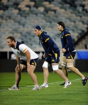 Ben Mowen, centre, leads Brumbies players during the Captain's Run at Canberra Stadium on Friday.