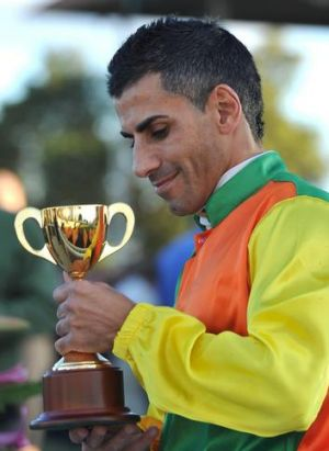 Jeff Penza celebrates winning his Wagga Cup aboard Canberra horse Coliseo on Friday.