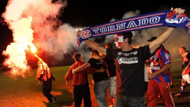 Canberra FC fans celebrate with flares after last year's grand final.