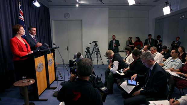 The fixer ... John McTernan watched Prime Minister Julia Gillard handle a press conference.