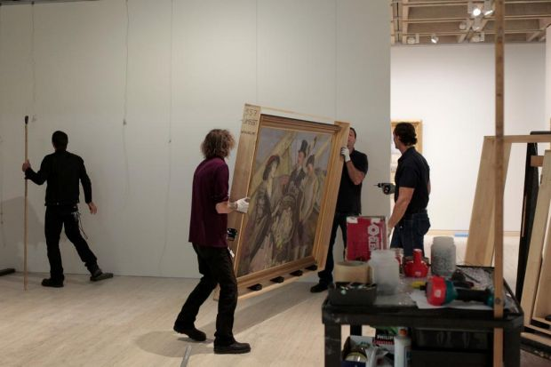 Artists and gallery workers, installing some of Australia's best works by home grown artists.