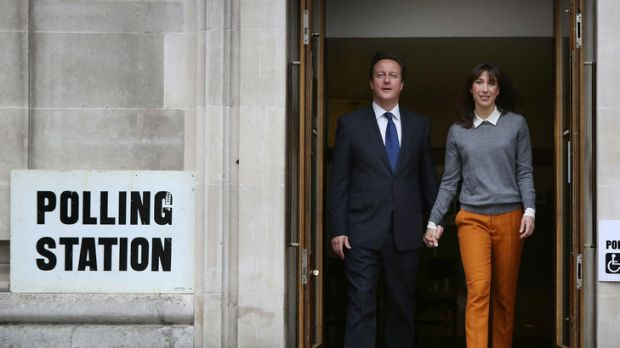 British PM David Cameron and his wife Samantha leave a polling station in London.