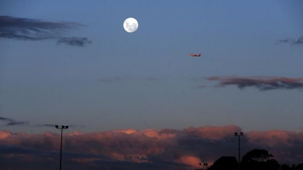 The moon rising over Canberra last night.