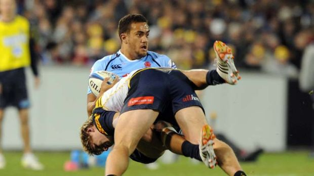 Over and out ... Peter Betham feels the full force of Brumbies defence.