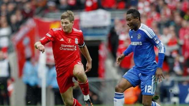 Chelsea's Nigerian midfielder John Obi Mikel  vies with Liverpool's English midfielder Steven Gerrard during the FA Cup ...