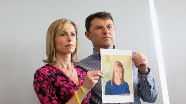 Kate and Gerry McCann holding an age-progressed police image of their daughter during a news conference to mark the 5th ...