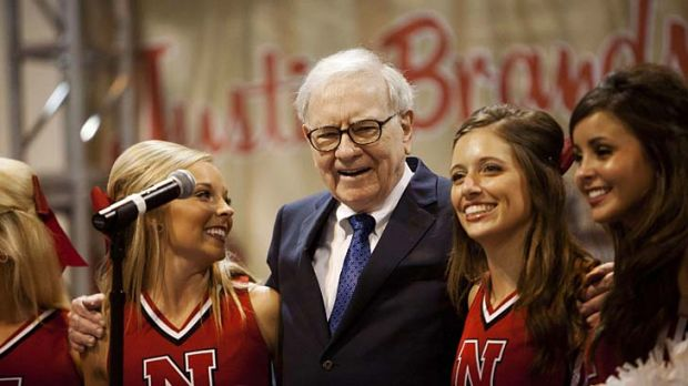 Eye to the future: Billionaire Warren Buffett, 80, and cheerleaders.