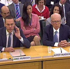 James and Rupert Murdoch at a parliamentary committee hearing in London.