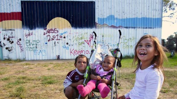 Fraught ... Maliesha Woodbridge, 7, in Toomelah with her brother Leslie and Tianna Hinch.