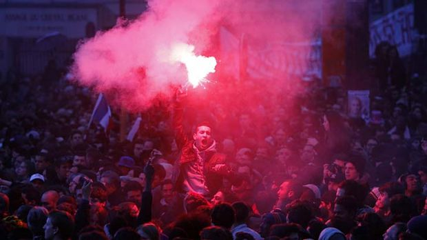 New era ... supporters of  Francois Hollande celebrate.
