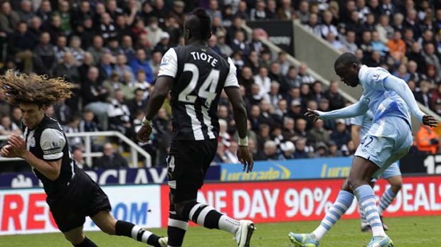 Manchester City's Yaya Toure (R) scores his first goal against Newcastle United.