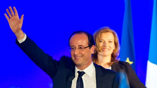 Behind her man ... Francois Hollande celebrates victory next to his partner Valerie Trierweiler.