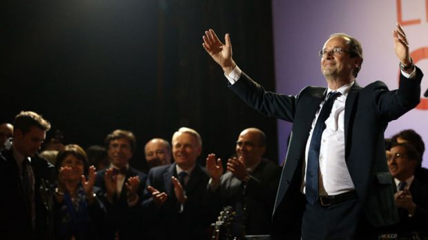 Long road to victory: Francois Hollande celebrates Sunday's win with the party faithful.