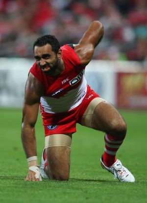 Adam Goodes of the Swans grimaces after tearing a muscle in his hip on Saturday.