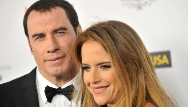 John Travolta with his wife Kelly Preston.
