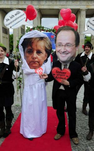 Shotgun wedding: Activists from Oxfam and the Attac group in Berlin ''marry'' Angela Merkel to Francois Hollande and his ...