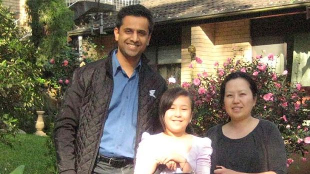 """""""Loving spirit"""" .. Mijin Shin, pictured with her husband Vishal, and her daughters Meera and Kelly."""
