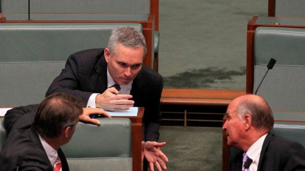 Craig Thompson talks with independents Rob Oakeshott and Tony Windsor during Christopher Pyne's attempt to force Mr ...