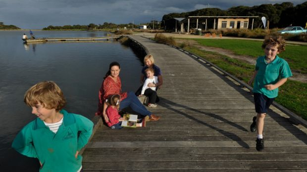 Surf Coast mothers Clare Eddy (left) and Suellen Eskrigge with their children on the Anglesea riverfront.