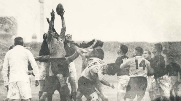 Players jostle for possession during the 1937 clash.
