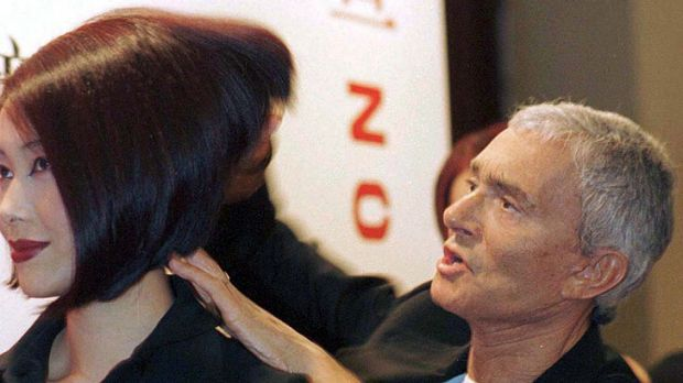 Working his magic ... Vidal Sassoon styles on a model in 1997.
