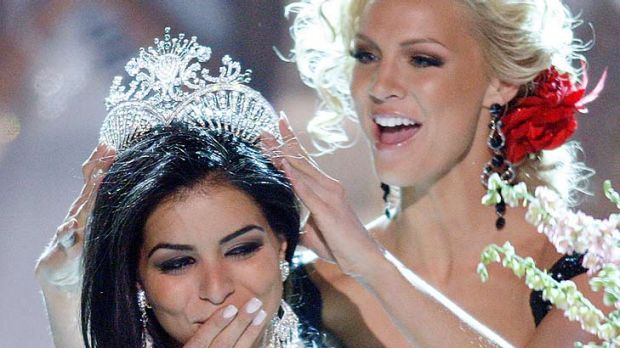 Too much champagne? ...  Rima Fakih is crowned Miss USA in 2010.